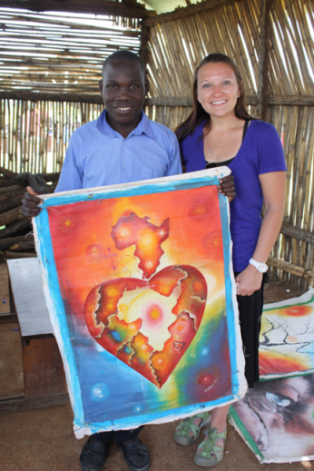 Artist and Restore Academy student Ivan and my friend Cindy. This piece of art perfectly describes how God has permanently impressed Africa on our hearts.